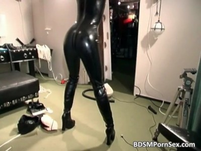 Bitch in black latex suit gets bound